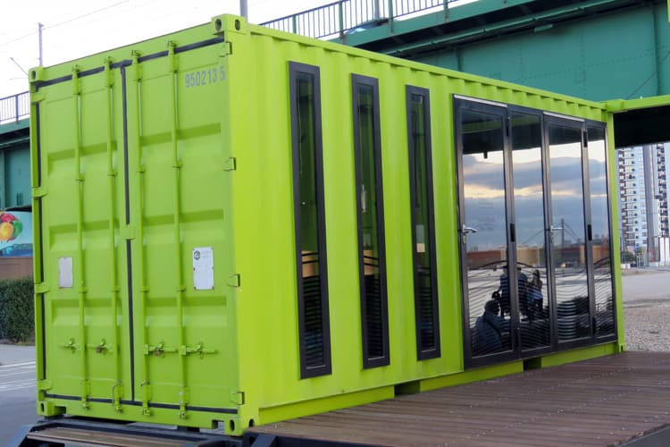 Customized container office assembled from 2 TEU modules houses local administration and information center. Belgrade on the Water (Serbia)
